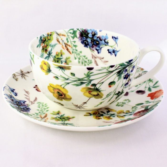 breakfast cup and saucer with meadow flowers, field poppy, kingcup, columbine and yellow rattle