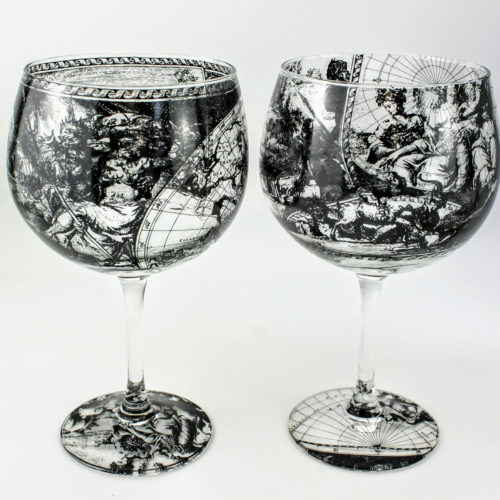 Gin and Tonic cocktail glasses with map design features allegorical scenes representing 'Fire' by war and destruction, 'earth' by harvesting
