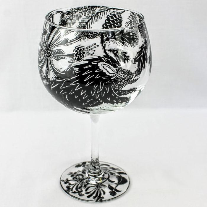 G & T stemware glass of a wild boar truffle hunter in a pine wood