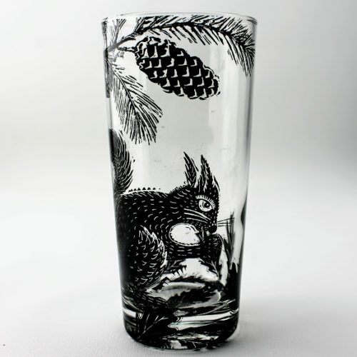 highball glass red squirrel n a pine woodland