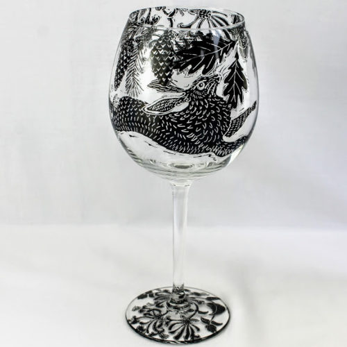 wine glass dancing hare in a oak and pine forest