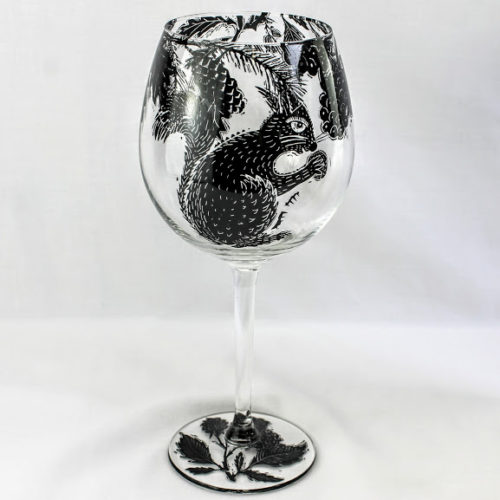 wine glass red squirrel in a woodland setting