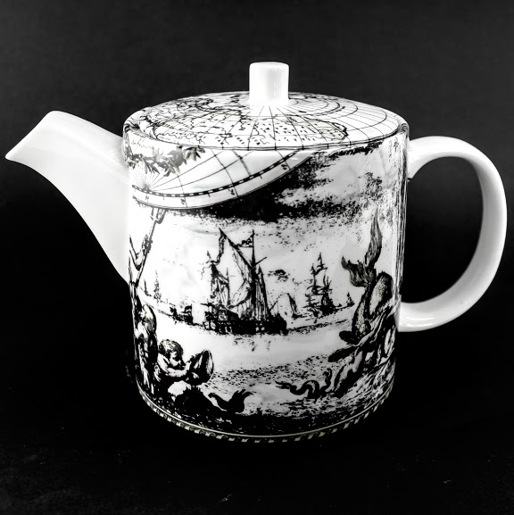 Tea pot based upon Frederick De Wit's first world map of 1668. the allegorical scene is sailing ships and a spouting whale.