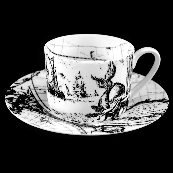 Handmade tea cup based upon Frederick De Wit's first world map of 1668. The allegorical scene is 'Water' illustrated with sailing ships and a spouting whale.
