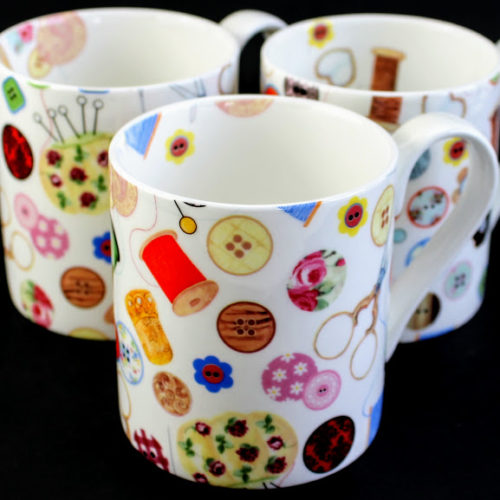 Stitching and sewing Bone china mug with buttons bobbins & thimbles