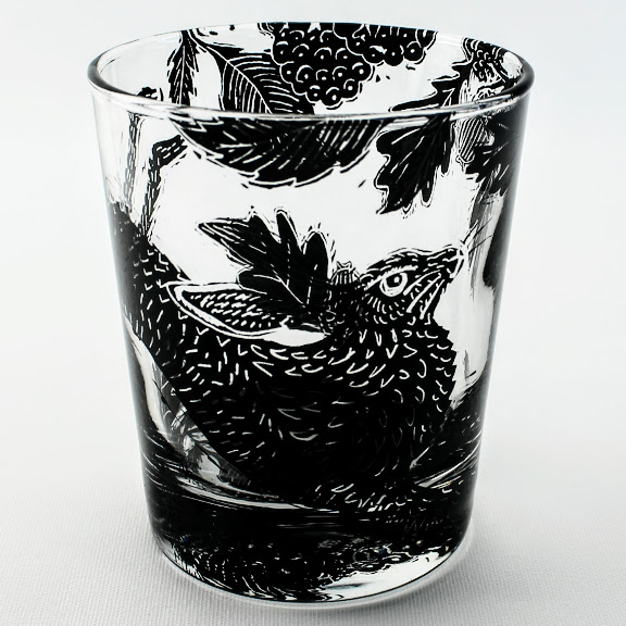 Whiskey tumbler glass woodcut style scene with a Hare in a oak wood