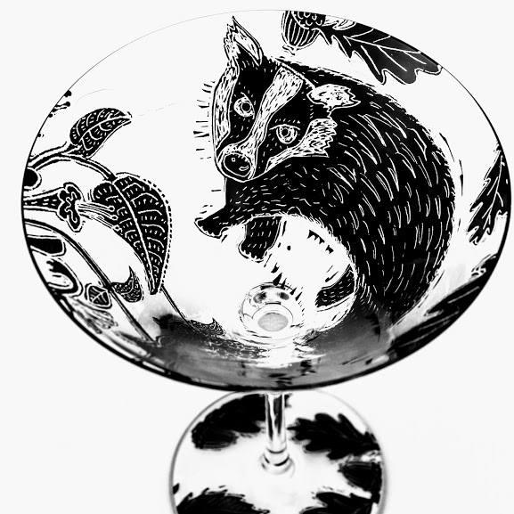 Martini glass with woodcut drawing of a british Badger and honeysuckle