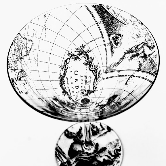 Martini Cocktail glass with 17th century world map