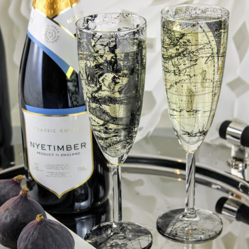 pair of champagne flutes, world map design with figs and Nyetimber English sparking wine