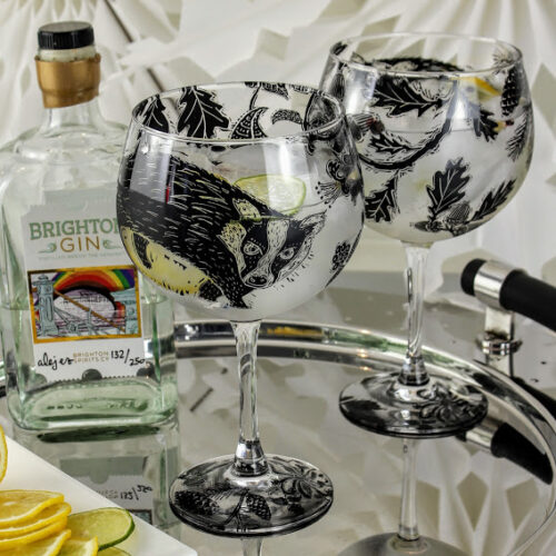 pair of gin & tonic glasses, badgers in a woodland forest bottle of Brighton Gin
