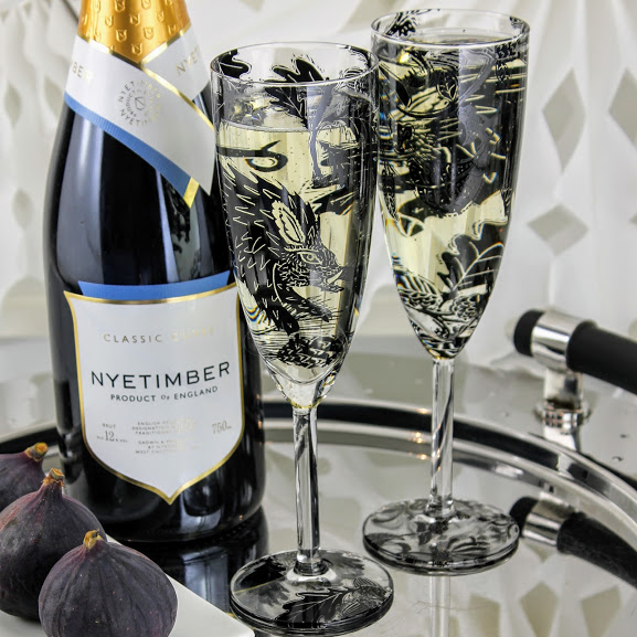 champagne flutes wild boar woodland scene with English sparkling wine Nyetimber