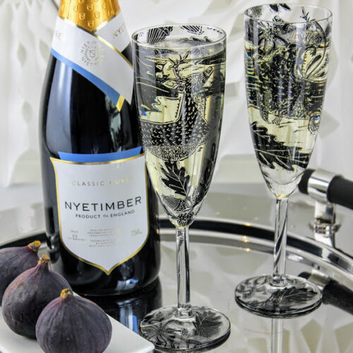 Nyetimber English sparkling wine champagne flutes of deer in a woodland glade