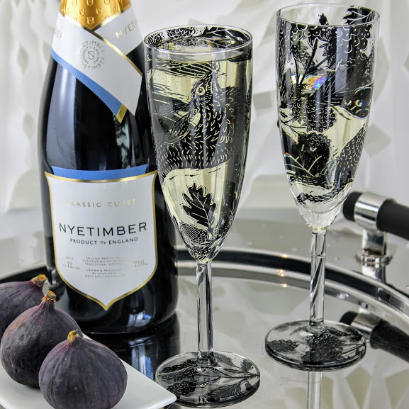 pair of champagne flutes woodland scene with hares and Nyetimber sparkling wine