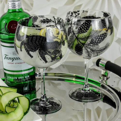 Tanqueray Gin pair of gin and tonic glasses with foxes in a woodland glade