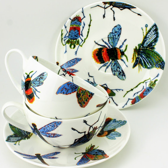 breakfast cappuccino cups covered in vivid bugs