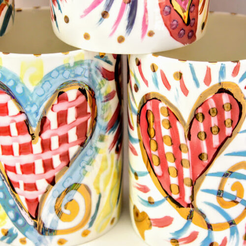 hand painted English bone china mug in vivid lustrous colours and gold highlights