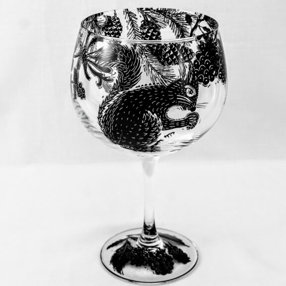 gin and tonic balloon glass woodland scene with squirrel