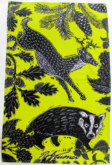 deer and badger in a woodland glade tea towel